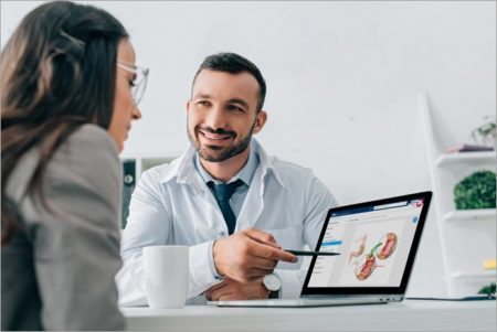 Healthcare provider educates a patient using the iMD Health Patient Engagement Platform