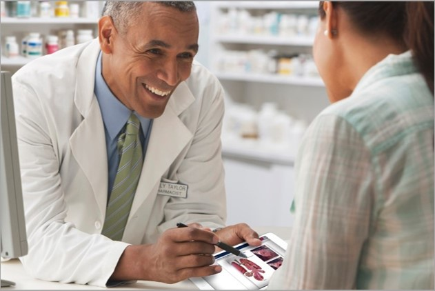 Pharmacist educates a patient using the iMD Health Patient Engagement Platform